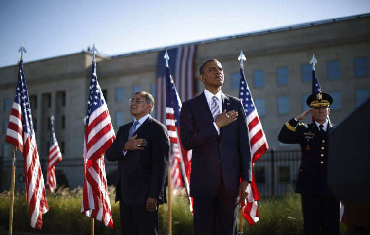 Image: U.S. President Obama, U.S. Secretary of Defense Panetta and Chairman of the Joint Chiefs of Staff Dempsey observe a moment of silence on the 11th anniversary of the 9/11 attacks at the Pentagon
