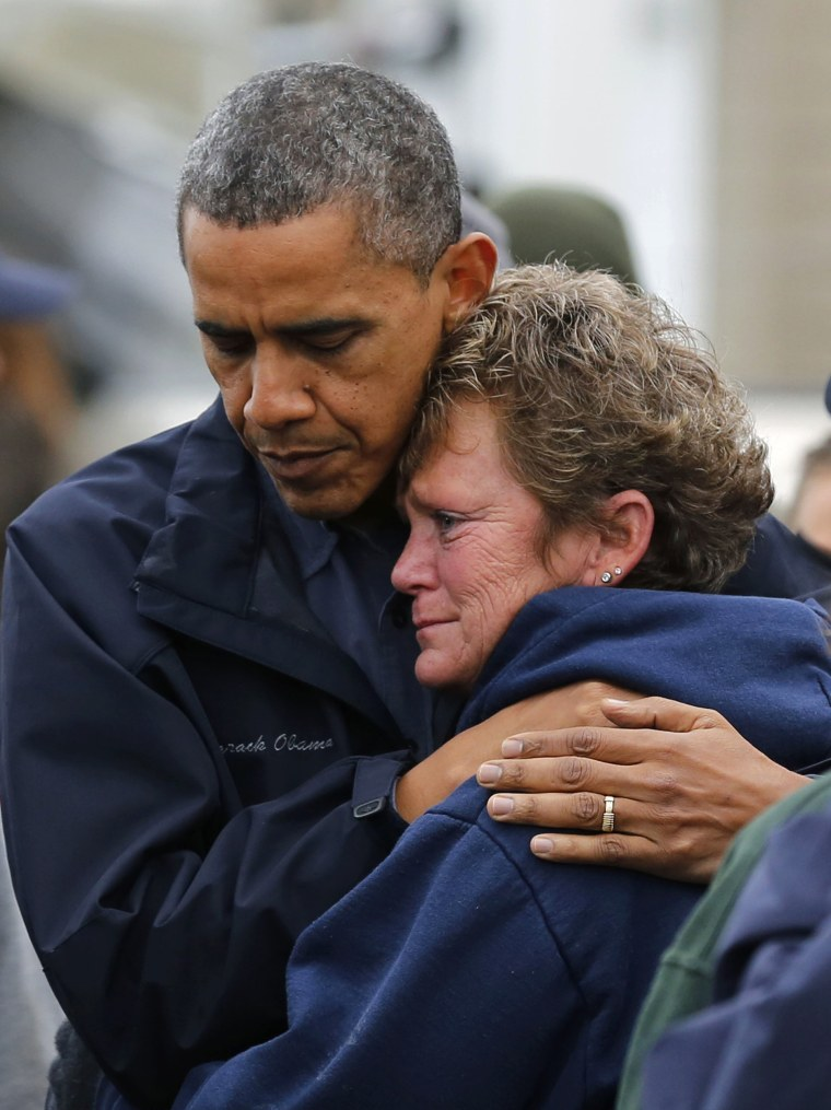 Image: U.S. President Obama hugs marina owner after it was destroyed by Hurricane Sandy in New Jersey