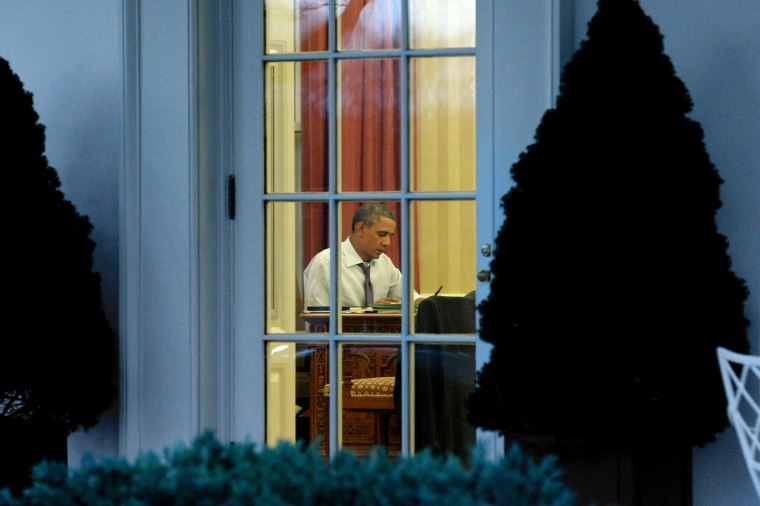 Image: President Barack Obama works on a draft of his State of the Union address