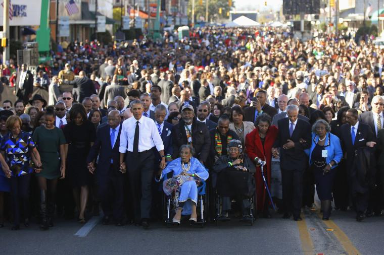 Image: Obama participates in a march across the Edmund Pettus Bridge in Selma, Alabama