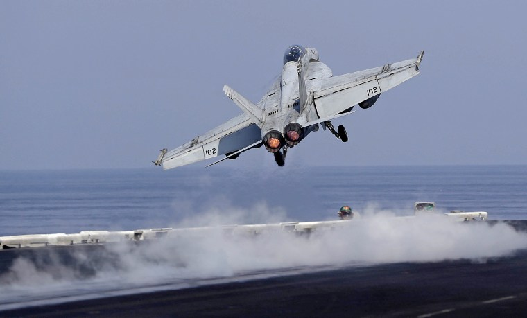 A U.S. Navy fighter jet takes off from the deck of the U.S.S. Dwight D. Eisenhower aircraft carrier, currently deployed in the Persian Gulf, supporting Operation Inherent Resolve, the military operation against Islamic State extremists in Syria and Iraq.