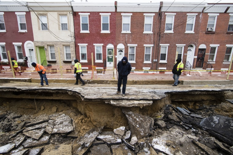 Image: Workers inspect a sinkhole in Philadelphia on Jan. 9.