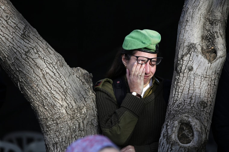 Image: An Israeli solider mourns at the grave of Israeli Army lieutenant Yael Yekutiel during his funeral at the Kiryat Shaul Military Cemetery in Tel Aviv, Israel on Jan. 9.
