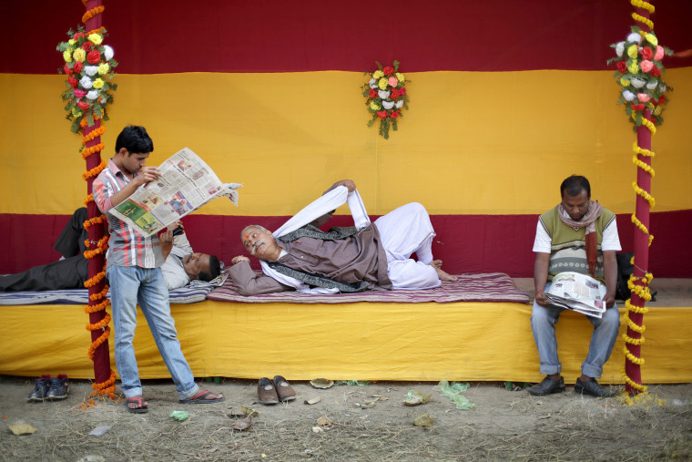 Image: Indian devotees rest at a makeshift tent inside a transit religious gathering ahead of the annual Gangasagar fair in Calcutta on Jan. 9.