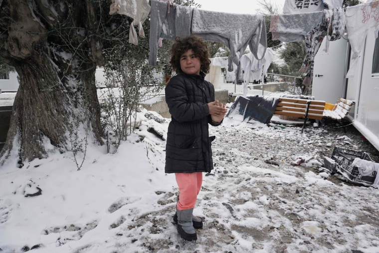 Image: A girl plays in the snow at the Kara Tepe camp on Lesbos, Greece.
