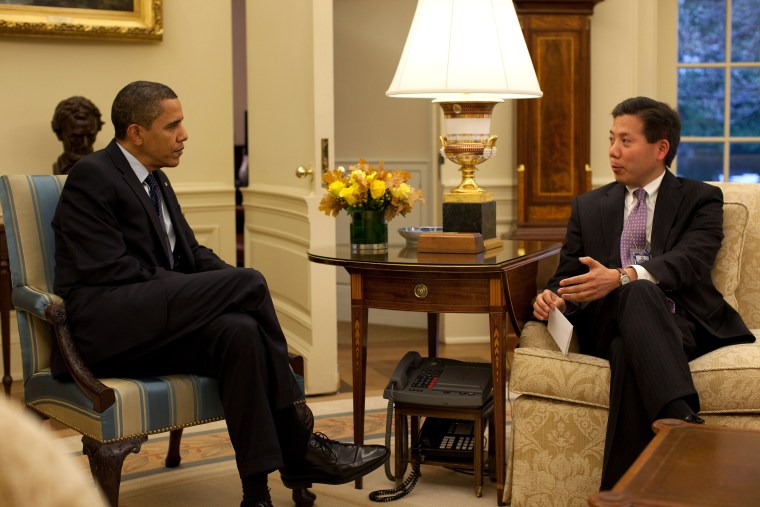 President Barack Obama  meets with Chris Lu, cabinet secretary, in the Oval Office prior to the Cabinet Meeting, Nov. 23, 2009.  (Official White House Photo by Pete Souza)