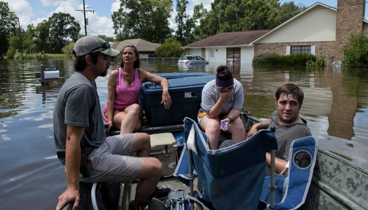 Image: As many as 30,000 people have been rescued following unprecedented floods in the southern US state of Louisiana