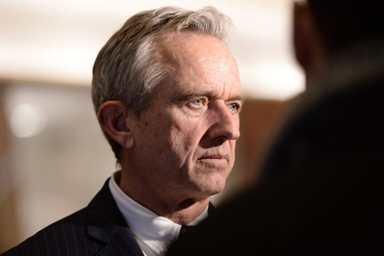 Image: Robert F. Kennedy Jr. talks to members of the media in the lobby of the Trump Tower in New York, New York on Jan. 10.
