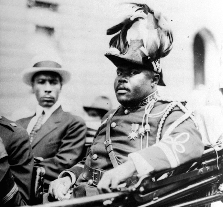 """In this August 1922 file photo, Marcus Garvey is shown in a military uniform as the """"Provisional President of Africa"""" during a parade on the opening day of the annual Convention of the Negro Peoples of the World along Lenox Avenue in Harlem borough of New York."""