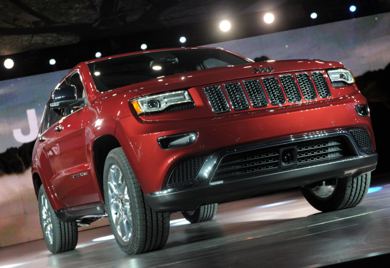 The 2014 Jeep Grand Cherokee revised design is introduced at the 2013 North American International Auto Show in Detroit, Michigan.