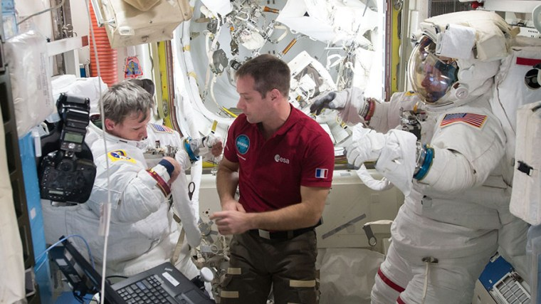 Image: Astronaut Thomas Pesquet (center) assists spacewalkers Peggy Whitson (left) and Shane Kimbrough in the U.S. Quest airlock on Jan. 6, 2017.