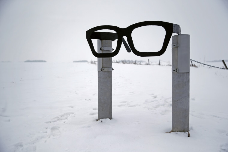 "A monument depicting musician Buddy Holly's glasses stands at the edge of a snowy field near the spot where the plane carrying  Holly, Ritchie Valens and J.P. ""The Big Bopper"" Richardson crashed near Clear Lake, Iowa, Friday, Jan. 8, 2016."