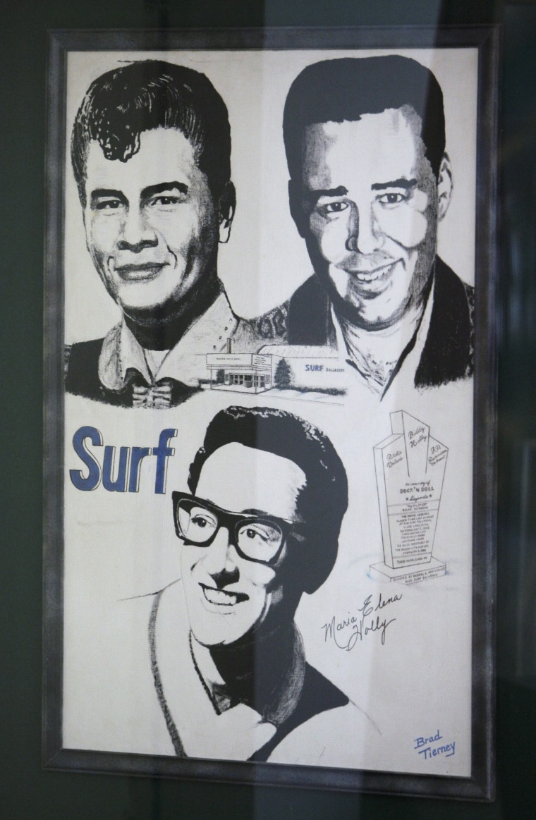 "This Jan. 9, 2009 photo shows a poster showing Buddy Holly, Ritchie Valens and J.P. ""The Big Bopper"" Richardson hangs on a wall in the Surf Ballroom in Clear Lake, Iowa, where the rock pioneers gave their last performance."