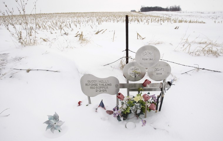 "Flowers adorn a memorial, Friday, Jan. 9, 2009, at the spot where the plane carrying Buddy Holly, Ritchie Valens and J.P. ""The Big Bopper"" Richardson crashed killing all aboard, Feb. 3, 1959, near Clear Lake, Iowa."