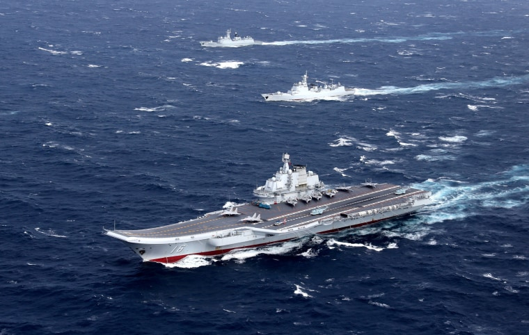 Image: FILE PHOTO: China's Liaoning aircraft carrier with accompanying fleet conducts a drill in an area of South China Sea