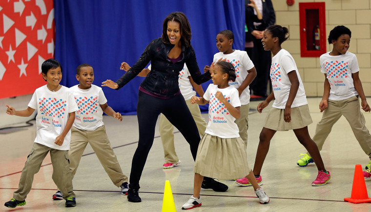 Image: Michelle Obama And Star Athletes Visit Washington DC Elementary School