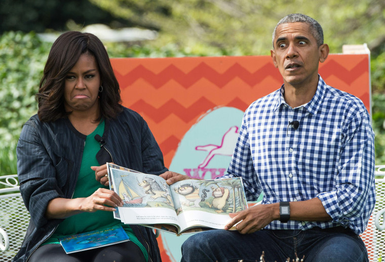 "Image: US President Barack Obama and First Lady Michelle Obama read Maurice Sendak's ""Where the Wild Things Are"" to children at the annual Easter Egg Roll at the White House"