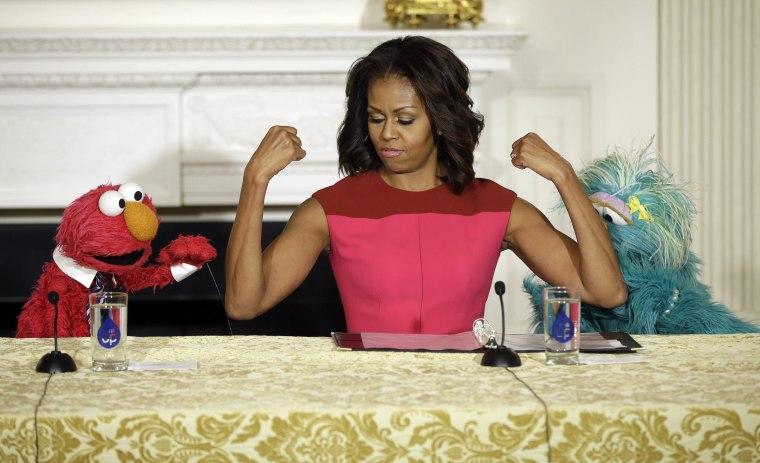 Image: Michelle Obama, Elmo, Rosita