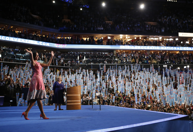 Image: First Lady Michelle Obama waves to delegates at the Democratic National Convention in Charlotte