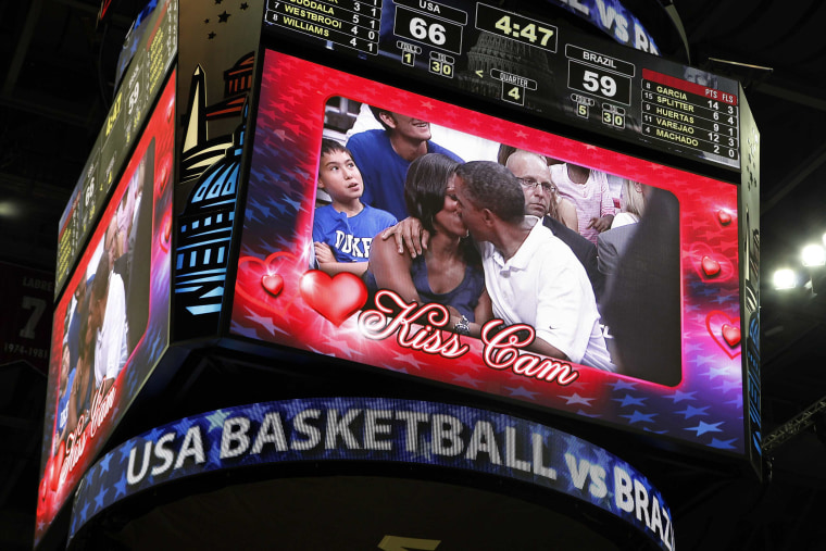 "Image: U.S. President Obama and first lady Michelle Obama are shown kissing on the ""Kiss Cam"" screen during a timeout in the Olympic basketball exhibition game between the U.S. and Brazil national men's teams in Washington"