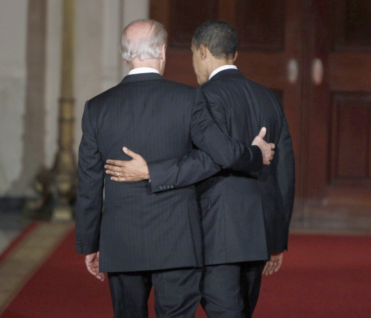 Image: U.S. President Barack Obama and Vice President Joe Biden walk arm-in-arm down the Cross Hall of the White House in Washington, March 21, 2010, after Obama spoke about the House of Representatives' final passage of health care legislation.