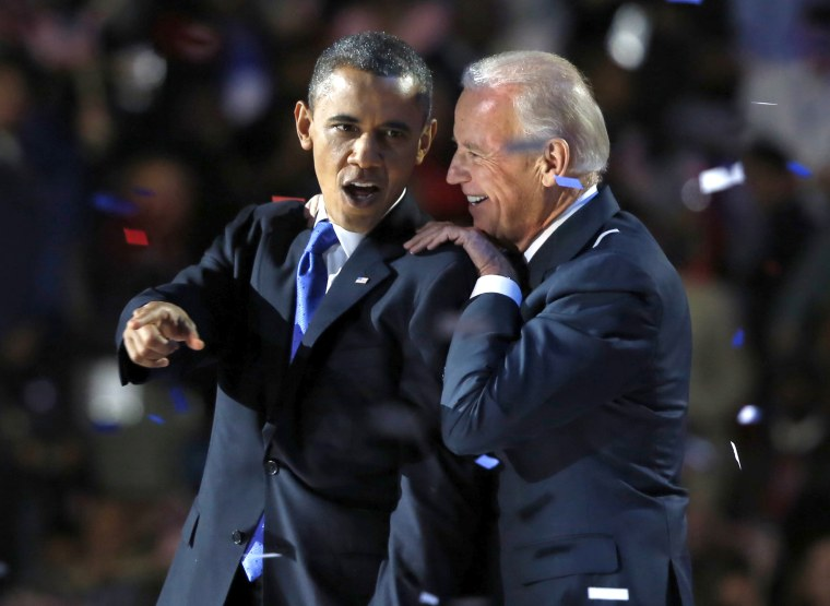 U.S. President Barack Obama gestures with Vice President Joe Biden after his election night victory speech in Chicago