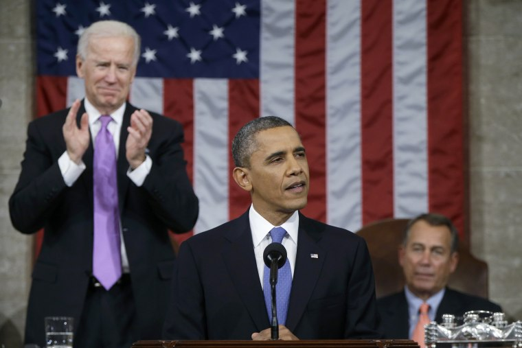 U.S. President Obama delivers his State of the Union speech between Vice President Biden and House Speaker Boehner on Capitol Hill in Washington