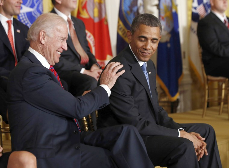 Image: U.S. Vice President Joe Biden shares a light moment with U.S. President Barack Obama during an event on finding employment for returning military veterans from their service, in the East Room of the White House in Washington, April 30, 2013.