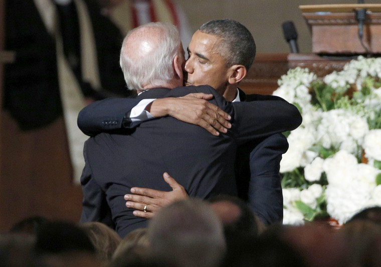 Image: U.S. President Barack Obama kisses Vice President Joe Biden on the cheek as he hugs him after delivering the eulogy during the funeral of Biden's son, former Delaware Attorney General Beau Biden, at St. Anthony of Padua church in Delaware.