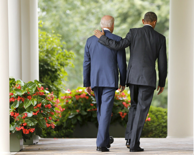 Image: U.S. President Barack Obama and Vice President Joe Biden walk back to the Oval Office after speaking about the Supreme Court ruling to uphold the nationwide availability of tax subsidies that are crucial to the implementation of the ACA.
