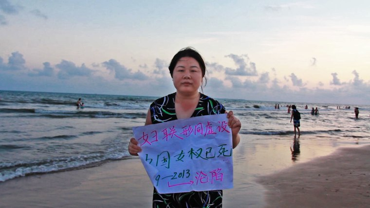 """In this still from """"Hooligan Sparrow,"""" Chinese activist Ye Haiyan holds a sign that reads """"China's women's rights are dead."""""""