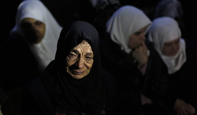 Image: Unidentified relatives of Mohamed al-Salihi react during his funeral at Al-Faraa Refugee Camp near the West Bank city of Nablus, Jan. 10.