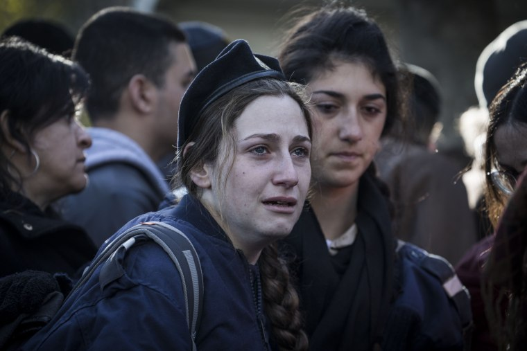 Image: Relatives and family members of Shira Hajaj mourn during her funeral on Jan. 9, in Jerusalem, Israel. Hajaj was one among the four soldiers killed during the truck attack the previous day.