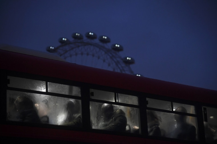 Image: Commuters ride a bus over Westminster Bridge past the London Eye during a strike on the Underground by members of two unions in protest at ticket office closures and reduced staffing levels, in London