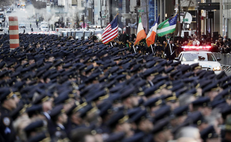 Image: Police officers fill New York's Fifth Avenue prior to the funeral for Detective Steven McDonald at St. Patrick's Cathedral in New York, New York on Jan. 13.