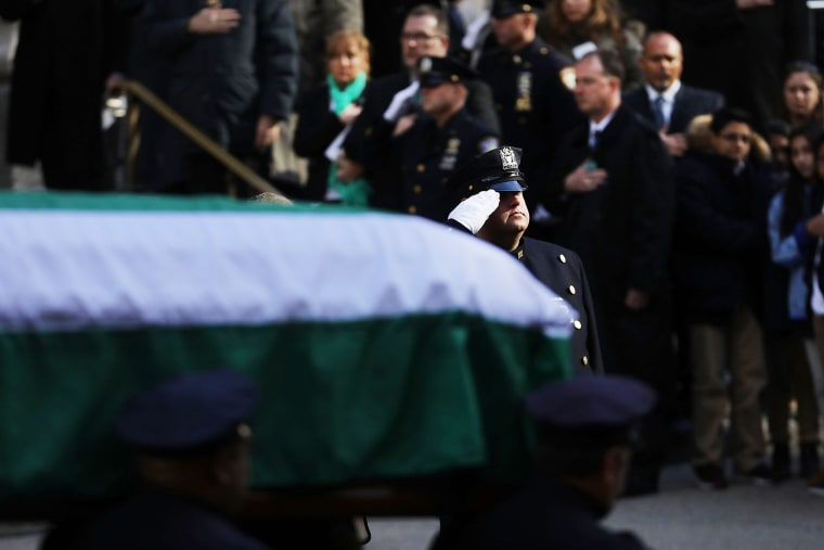 Image: The casket of Detective Steven McDonald is brought out of St. Patrick's Cathedral during his funeral on Jan. 13 in New York City.