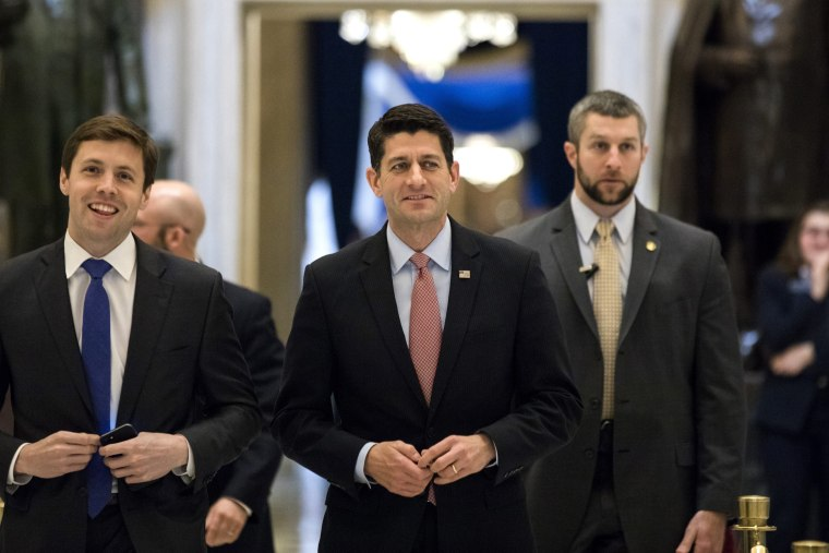 Image:  Ryan walks to the House floor where representatives were voting on a budget resolution