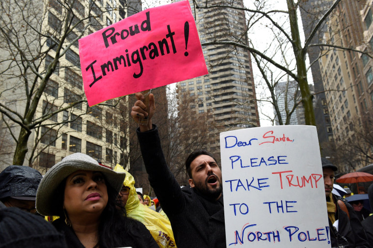 Image: People protest before marching to Trump Tower during a demonstration organized by the New York Immigration Coalition against President-elect Donald Trump in the Manhattan borough of  New York