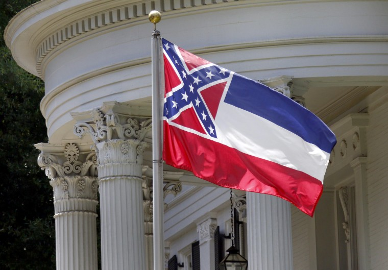 Image: The Mississippi state flag is unfurled against the front of the Governor's Mansion in Jackson, Mississippi, 2015.