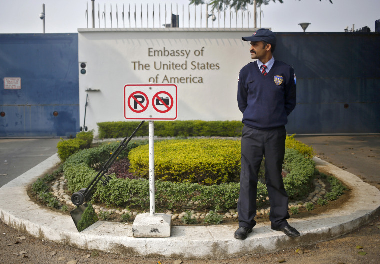 Image: A private security guard stands outside the U.S. embassy in New Delhi December 18, 2013.