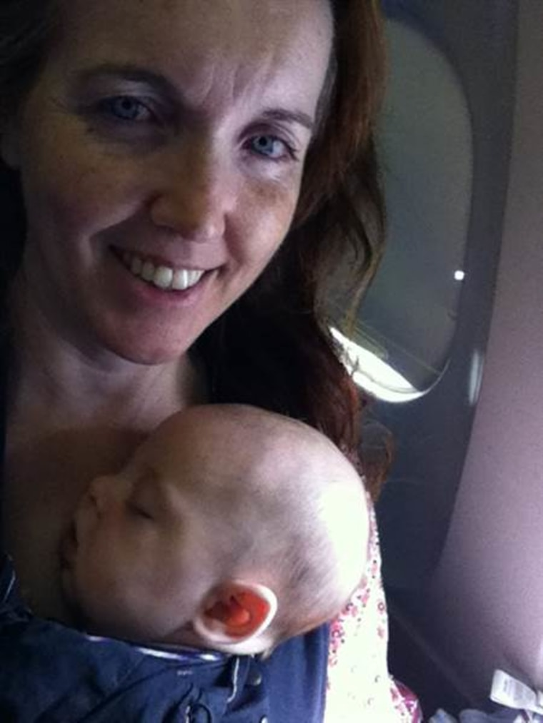 Rebecca Dube and her baby Joseph on a flight