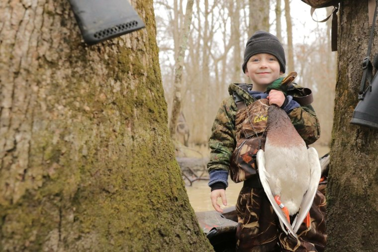 Tripp Halford, 5, with a duck on his first hunting trip.