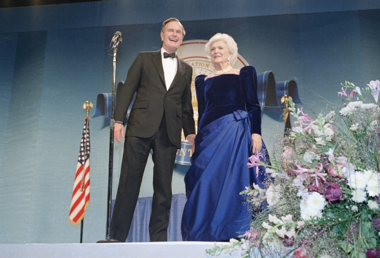 President George H.W. Bush and Barbara Bush attend the inaugural ball.