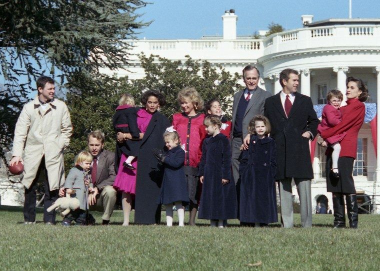 An informal photo of President Bush with some of his children and grandchildren on the White House lawn on Jan 21, 1989.