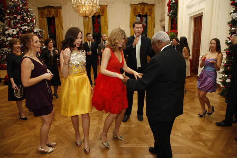 The Bush sisters dance with staff during a family holiday party at the White House.