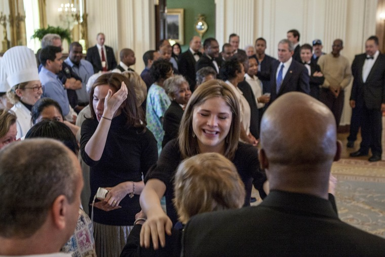 A tearful Barbara Bush and Jenna Bush Hager give hugs with White House staff in the East Room of the White House.