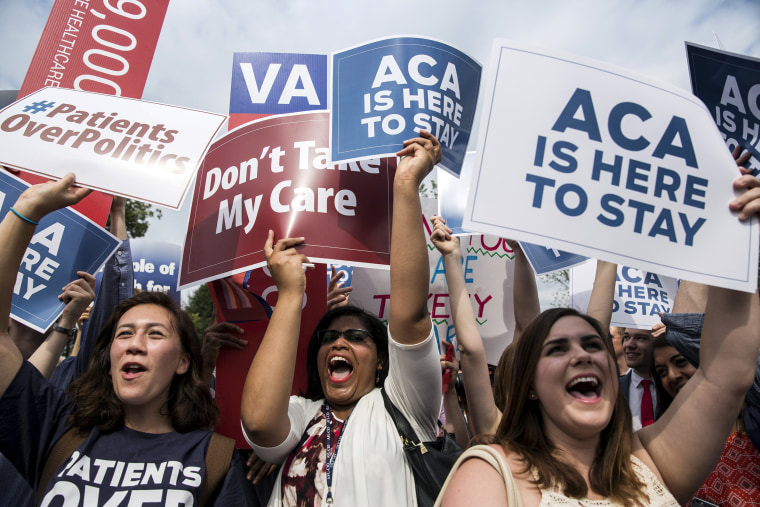 Image:  Supporters of the Affordable Care Act celebrate after the Supreme Court up held the law in the 6-3 vote at the Supreme Court in Washington