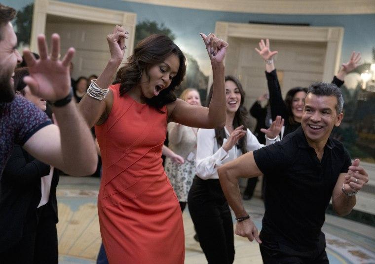 Image: Michelle Obama, Josh Segarra, Sergio Trujillo