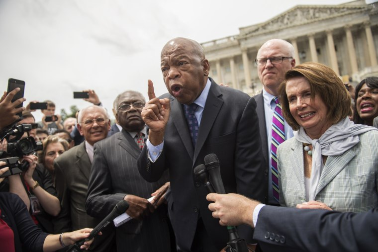 Image: Rep. John Lewis, D-Ga., and House Minority Leader Nancy Pelosi, D-Calif., along with other members, address demonstrators on the East Front of the Capitol after the House Democrats' sit-in ended on the floor, June 23, 2016.