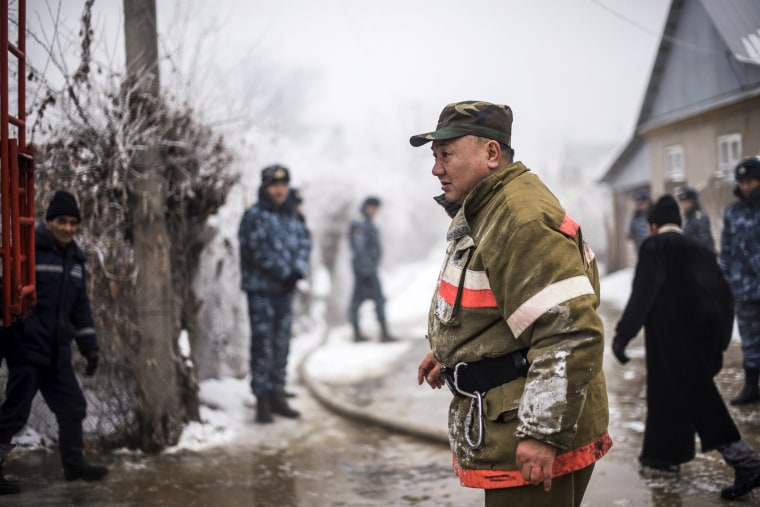 Emergency workers arrive to the site of the crash of the Boeing 747 that went down in the village of Dacha-Suu.